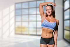 Composite image of portrait of happy female athlete with hand on head Royalty Free Stock Photos