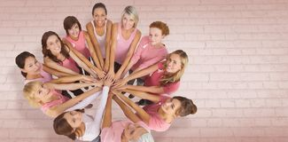 Composite image of portrait of happy female friends supporting breast cancer awareness Royalty Free Stock Image
