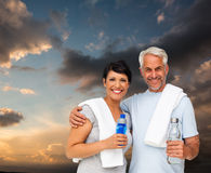 Composite image of portrait of a happy fit couple Royalty Free Stock Photography