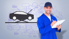 Composite image of portrait of happy male mechanic writing on clipboard Royalty Free Stock Images