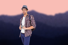 Composite image of portrait of happy man holding camera Stock Photo