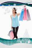 Composite image of portrait of a happy woman showing shopping bags Stock Images