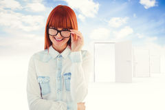 Composite image of portrait of a hipster woman front of post-it Royalty Free Stock Photography