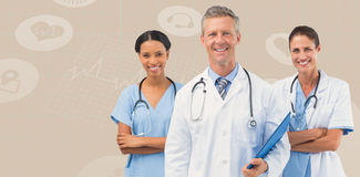 Composite image of portrait of male doctor with female staffs. Portrait of male doctor with female staffs against beige background stock photos