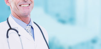 Composite image of portrait of male doctor smiling Royalty Free Stock Photography