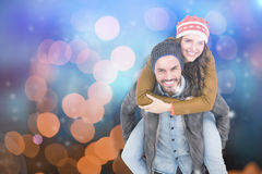 Composite image of portrait of man giving piggyback ride to woman Stock Photography