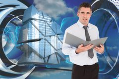 Composite image of portrait of a man holding a binder Royalty Free Stock Photo