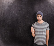 Composite image of portrait of man holding smoking pipe Stock Images
