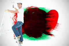 Composite image of portrait of man on ladder painting with roller Stock Photography