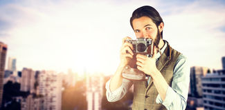 Composite image of portrait of man photographing through vintage camera Royalty Free Stock Photo