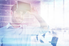 Composite image of portrait of man with virtual reality headset 3d Stock Photo