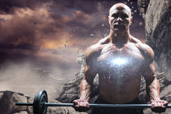 Composite image of portrait of muscular man lifting crossfit Stock Photography