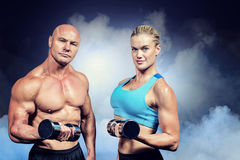 Composite image of portrait of muscular man and woman lifting dumbbells stock images