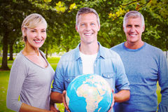 Composite image of portrait of people with globe Royalty Free Stock Images