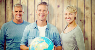 Composite image of portrait of people with globe Royalty Free Stock Image