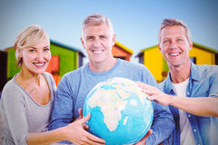 Composite image of portrait of people holding globe Royalty Free Stock Photo
