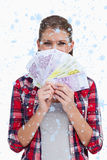 Composite image of portrait of a rich woman holding bank notes Stock Photography