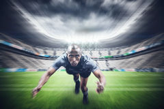 Composite image of portrait of rugby player jumping Royalty Free Stock Photos