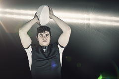 Composite image of portrait of a rugby player throwing a ball Royalty Free Stock Photography