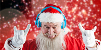 Composite image of portrait of santa claus gesturing Stock Photography