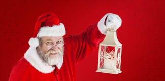 Composite image of portrait of santa claus holding christmas lantern Stock Photography