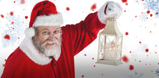 Composite image of portrait of santa claus holding christmas lantern Royalty Free Stock Images