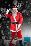 Composite image of portrait of santa claus standing with guitar and various gift Royalty Free Stock Photos