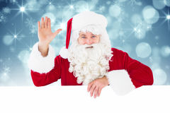 Composite image of portrait of santa claus waving Royalty Free Stock Photo