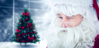 Composite image of portrait of santa claus winking Royalty Free Stock Photos