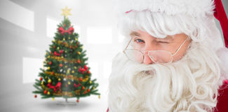 Composite image of portrait of santa claus winking Royalty Free Stock Images