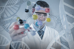 Composite image of portrait of scientist holding molecule structure Stock Photography