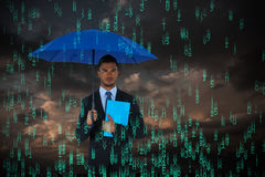 Composite image of portrait of serious businessman holding blue umbrella and file. Portrait of serious businessman holding blue umbrella and file  against blue Royalty Free Stock Image