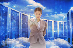 Composite image of portrait of a serious businesswoman pointing at the viewer Royalty Free Stock Photos