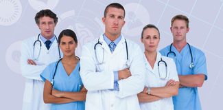 Composite image of portrait of serious doctors standing with arms crossed Stock Photography