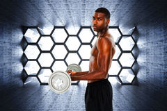 Composite image of portrait of a serious fit young man lifting barbell Stock Photo