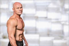 Composite image of portrait of shirtless bald man Stock Photo