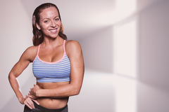 Composite image of portrait of smiling athlete with hands on hip Stock Images