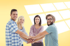 Composite image of portrait of smiling business people putting their hands together Royalty Free Stock Photos