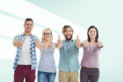 Composite image of portrait of smiling business people with thumbs up Stock Images