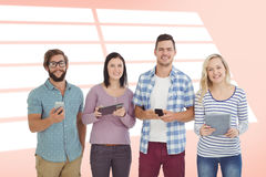 Composite image of portrait of smiling business people using electronic gadgets Stock Images