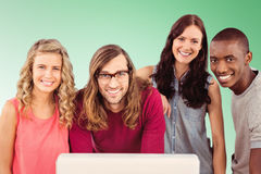 Composite image of portrait of smiling business team standing at computer desk Stock Photography