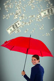 Composite image of portrait of smiling businesswoman holding red umbrella Royalty Free Stock Photo