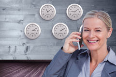 Composite image of portrait of smiling businesswoman using mobile phone Royalty Free Stock Photos