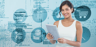 Composite image of portrait of smiling businesswoman using tablet computer Stock Photography