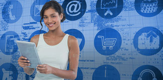 Composite image of portrait of smiling businesswoman using tablet computer Royalty Free Stock Image