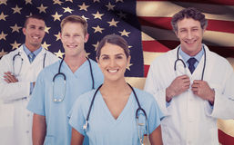 Composite image of portrait of smiling doctor standing with colleagues Stock Images