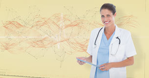 Composite image of portrait of smiling female doctor holding digital tablet Royalty Free Stock Photography