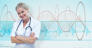 Composite image of  portrait of smiling female doctor standing arms crossed Stock Images