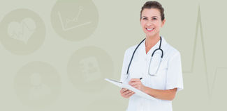 Composite image of portrait of smiling female doctor writing on clipboard Royalty Free Stock Image