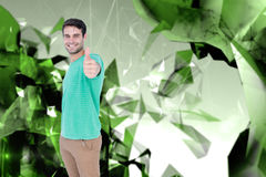 Composite image of portrait of smiling handsome man gesturing thumbs up Royalty Free Stock Images